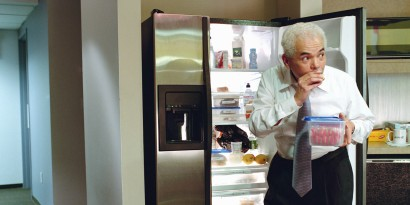 Businessman taking food from office refrigerator